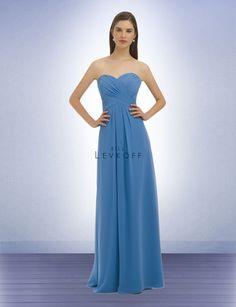 Chiffon strapless gown with a sweetheart neckline. Criss-cross ruching and pleats adorn the bodice. Lace back corset with modesty piece