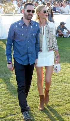Kate Bosworth is wearing a white shift dress with ankle boots, a mini white bag and an embroidered denim jacket. Michael Polish wears a denim  shirt with jeans and black shoes.
