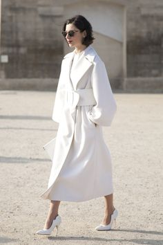 White stilettos, overcoat, & shirt, black lob & eyeshades, red lips