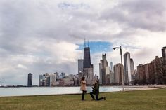 Surprise Chicago Proposal with Chicago skyline on a chilly March afternoon. Chicago proposal photographer Emma Mullins Photography, March 2017.