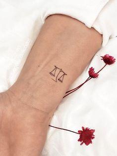 Small Libra scale on the wrist by @tatuagens_deliicadas Libra Scale Tattoo, Libra Tattoo, Libra Constellation Tattoo, Devil Tattoo, Leo Tattoos, Zodiac Tattoos, Symbol Tattoos, Girly Tattoos, Hand Tattoos