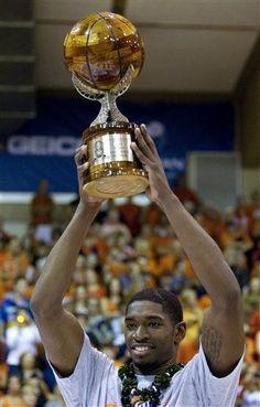 Illinois guard Brandon Paul holds up the 2012 EA Sports Maui Invitational MVP trophy.