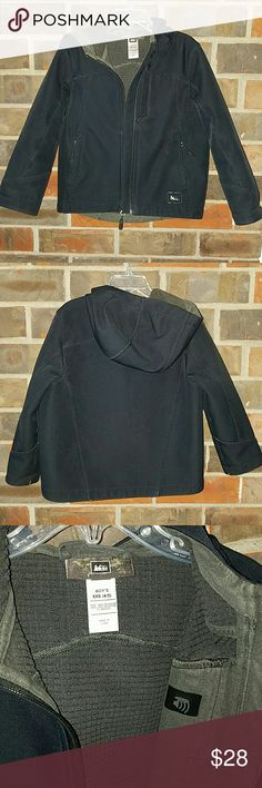 REI kids jacket black XXS (4/5) $110 Kids hooded black REI wind resistant jacket similar to an Arc'Teryx. Has two hand pockets & iPod pocket with headphones access. Tags says Boys XXS (4/5), but can be worn by a girl as well. In good condition with some wear on the outer arm seams and cuffs as shown. Great jacket for a great price! Retail $110. REI  Jackets & Coats
