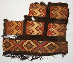Nazca textile fragment; 100BC-600; squares of border strip of cross-knit loop stitching, warp-faced plain weave in between; fringing along bottom edge; featu...
