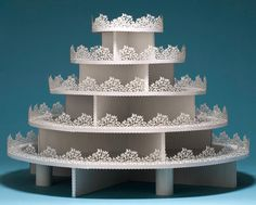 This is a beautiful cupcake tower!  A few rhinestones here and there would really make it an eye-catcher!  www.getcupcakepants.com