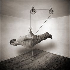 'Learning to fly at home, Lesson 8' (2010) by French photographer Yves Lecoq (b.1946). ty, the improvised life. via the photographer on flickr
