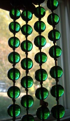 """Vintage Emerald Green Glass Pools of Light Bead Necklace Heavy Glowing 64"""". $45.00, via Etsy."""
