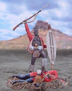 Triumphant Zulu warrior stands above his kill!