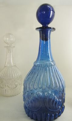 This c. 1830-1840 mold-blown Shell and Ribbing Cobalt Decanter was made by the Boston & Sandwich Glass Company.
