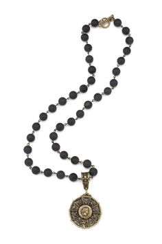 """24"""" sandblast black jasper and brass wire with antiqued brass-clad FK teardrop bail, Honour medallion and Camerone back plate by French Kande"""