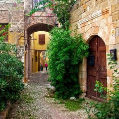Narrow street in old town / Rhodes Greece Places To Travel, Places To See, Old Street, Albania, Greece Travel, Greek Islands, Old Town, Beautiful Landscapes, Beautiful Places