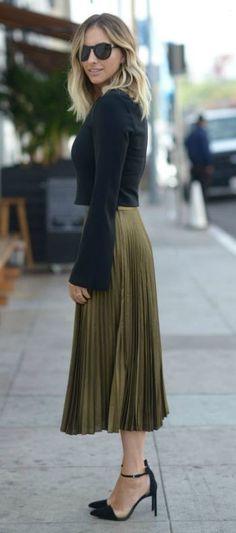 Emily Schuman + sleek + elegant + ultra feminine + gorgeous pleated skirt + bell sleeved crop top + heels + classy winter style + love the simplicity of this look! Top: Elizabeth and James, Skirt: Club Monaco, Shoes: Zara.... - Street Fashion