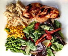 5 ounces balsamic grilled chicken (see marinade recipe above = 180) + 1 1/2 cups mixed green salad with 1 tablespoon Ken's Lite Caesar Dressing (15 for veggies + 40 for dressing = 55) + 1/2 cup steamed green peas (60) + 1/2 cup steamed corn (80) + 2/3 cup pasta salad (our family used Betty Crocker Suddenly Salad in Creamy Italian flavor, which is delicious. A 2/3 cup serving = 310) = 685