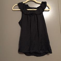 Forever 21 black ruffle tank 100% polyester. Dry clean only. A really nice, light fabric. Great for work or with a casual outfit. Worn a handful of times so still in great condition! Forever 21 Tops Tank Tops