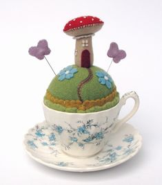 gorgeous felted pincushion in a teacup with adorable mushroom!