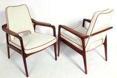 Pair of Danish Modern Lounge Chairs attributed to Sigvard Bernadotte | From a unique collection of antique and modern armchairs at https://www.1stdibs.com/furniture/seating/armchairs/
