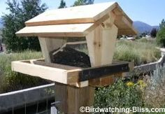 With these bird feeder plans, you can build a large capacity hopper style bird feeder that keeps the seed dry and is easy to refill and clean. Large Bird Feeders, Bird Feeder Poles, Wood Bird Feeder, Bird House Feeder, Bird House Plans, Bird House Kits, Bird Tables, Homemade Bird Houses, Easy Bird
