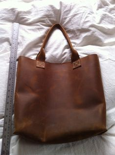 simple handmade leather bag, from Etsy originally I think, simple lines and gorgeous leather, what more could you want?