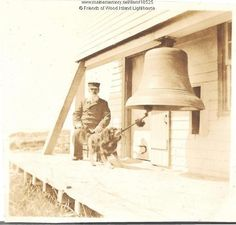 The dog in this picture is Sailor, who was famous for ringing the fog bell at Wood Island Lighthouse. The keeper, Thomas Henry Orcutt (1886-1905) watches as Sailor clasps the rope attached to the bells' clapper...