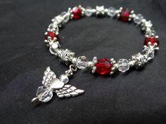 piedras rojas, colgante corazon con alas
