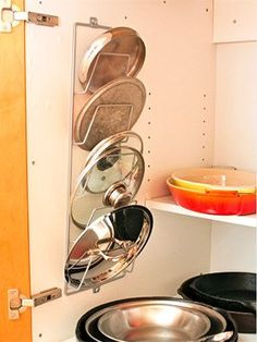 Magazine Rack Pot Lid Organizer | iVillage.com: 13 Genius Home Organizing Hacks We Wish We'd Thought Of | Comcast.net