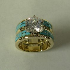 Gold and Turquoise Engagement / Wedding Set. Love the engagement ring. I'd rathe… Gold and Turquoise Engagement / Wedding Set. Love the engagement ring. I'd rather have a diamond band. and id rather have it SILVER Turquoise Wedding Rings, Turquoise Rings, Diamond Wedding Rings, Diamond Bands, Diamond Engagement Rings, Diamond Jewelry, Western Engagement Rings, Diamond Bracelets, Wedding Engagement