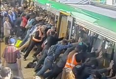 Commuters rally to push train off trapped man.