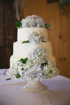 The wedding cake was adorned with a dot pattern and fresh hydrangeas. Cake: Katy McEntire
