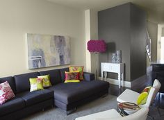 Great way to feature an accent wall  with a small pop of a dark color without overwhelming the space