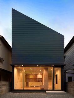 "Japanese architect Shintaro Fukuhara has completed a house with a steeply angled roof in Kobe, as a home for himself and his family. It features a glass facade like a ""showroom. Modern Architecture Design, Minimalist Architecture, Japanese Architecture, Residential Architecture, Interior Architecture, Innovative Architecture, Black House Exterior, Interior And Exterior, Interior Tropical"