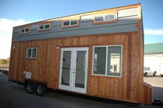 This is a26′ Tiny House RV with Shed-style Roof by Tiny Idahomes. It features two skylights, french doors, and a combination of cedar and metal siding on the outside. When you go inside, you…