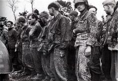 These prisoners from the 12th SS Hitlerjugend Division were captured during the early portion of the battle for Caen.