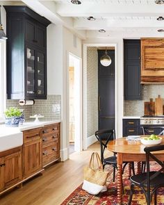 mixed wood and painted cabinets