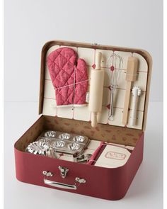 This children's baking kit makes us wish we were kids again! Get it here: http://www.bhg.com/shop/anthropologie-childs-activity-kit-p50946f6ae4b03f3db75e4fce.html