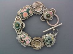 A bracelet that is beautiful from all angles. Six ocean jasper cabochons set in sterling silver. Candy for the eye.