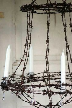 Barb wire chandelier for Halloween, can usually find bendable fake barb wire at craft stores or online.
