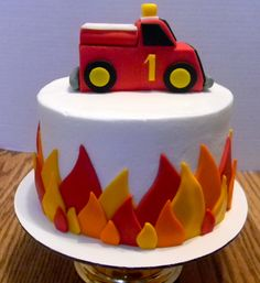 Firetruck Cake. Adorable @Nissa Little Little Cardenas I don't like this firetruck but the flame idea is cute and simple