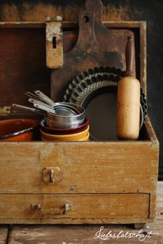 Antique & primitive box of well used kitchen items..