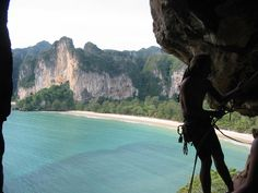 railay, thailand / abseiling from the thaiwand wall (sunset bay side). a 250m cave leads through the mountain and connects sunset bay - pranang beach