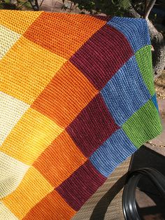 "Pattern description from Last-Minute Knitted Gifts: ""This blanket is knit entirely in garter stitch in seven strips of seven colors. Although one person…"