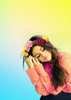 Selena Gomez-this is a cute picture! Love the background and the flowers in her hair.