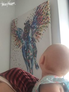 Baby can't stop staring at their Pegasus print by tracey keller