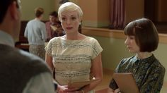 Call the Midwife; love how Trixie's dress has buttons starting at the middle of her dress!