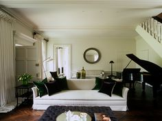 Kent.  Ebonised herringbone floor. Elegant mouldings.  Jib doors.  Main sofa is the 'Brian Junior' from Axel Vervoordt, covered in his 'Sylt Blamine' fabric.  Silk velvet cushion fabric from De La Cuona.