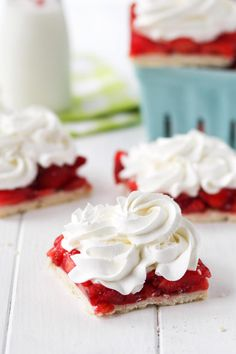 Strawberry Pie Bars can be topped with whipped cream. So, so good!