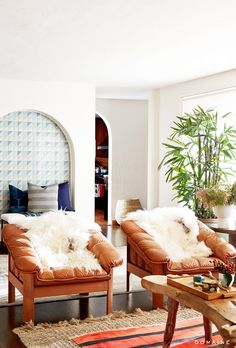 Bright space with leather armchairs