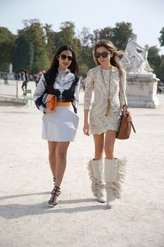 """Nausheen Shah, writer, and Erica Pelosini, editor  Nausheen: """"I'm wearing Delirious sunglasses with a Georgina Hardinge top and skirt, Valentino shoes, a Khir Ma Elzov clutch and Annelise Michelson rings.""""   Erica: """"I'm wearing Celine sunglasses with an Isabel Marant dress and boots, and a vintage Givenchy bag."""""""