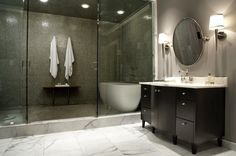 shower and tub combo - wet area - towels hung in shower area