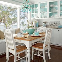 Bring in some color. One of the most frequently used areas in the home, the tiny breakfast nook off the kitchen is where the family shares their daily meals. The owner commissioned the custom built-in and painted the backs of the shelves a pretty sky blue shade to make her white dinnerware pop.