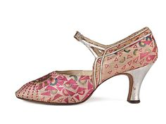 Pink geometric patterned brocade shoes, decorated with silver leather appliqué. by Wade Bros, 20's. USA
